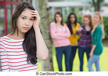 Student being bullied by a group of students - Portrait of a...