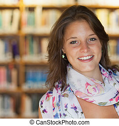 Smiling female student in the library