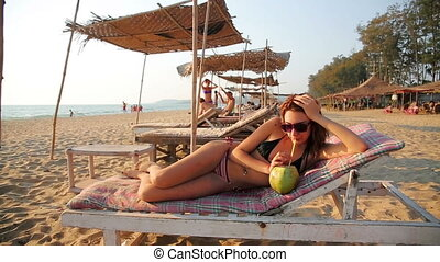 Attractive young woman on beach - Attractive young woman...