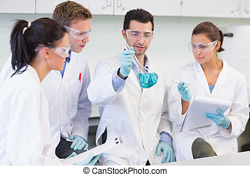 Scientists working on an experiment at the lab