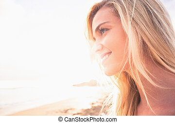 Close up of a smiling blond looking