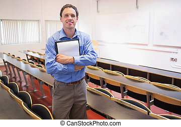 Male teacher with notepad in the lecture hall - Portrait of...