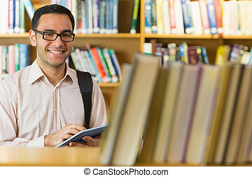 Smiling mature student using tablet - Portrait of a smiling...