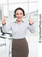 Portrait of an elegant businesswoman wearing headset while...