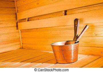 Copper pail and dipper in finnish sauna, horizon format