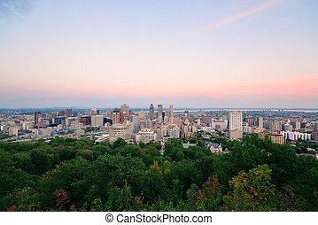 Montreal city skyline at sunset viewed from Mont Royal with...