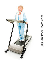 Senior Lady on Treadmill - Beautiful senior woman stays fit...
