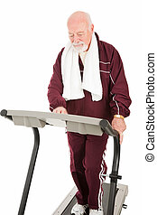 Senior man on Treadmill - Fit senior man working out on...