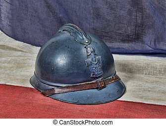 french ww 1 helmet on the antique french flag - french...