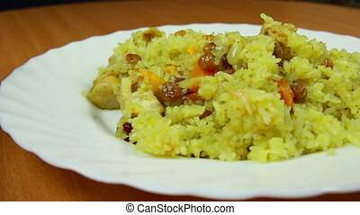Hot pilaf in plate, dolly shot