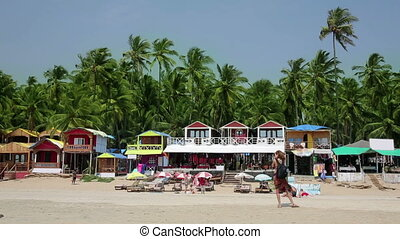 Woman photographing beach houses - Female tourist...