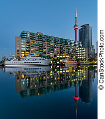 CN Tower with boat and reflection - Toronto harbour with CN...