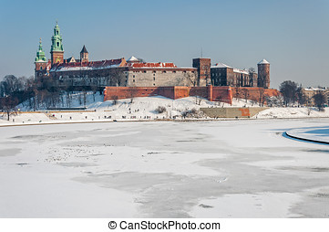 Wawel Castle in Krakow and frozen Vistula river in winter