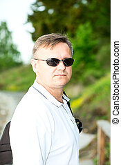 Man with sunglasses and polo shirt - Man with dark...