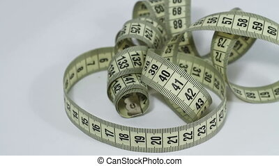 Tape measure rotating close up