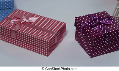 Present boxes rotating close up