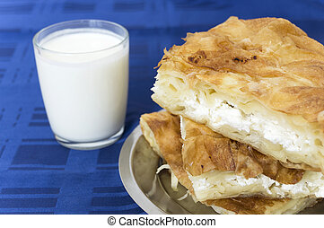 Burek and yogurt - Burek with cheese and a cup of yogurt