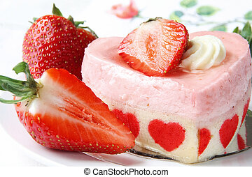 Heart shaped cake with fresh strawberry decoration