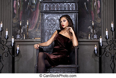 Sexy glamor lady sits on the throne - Glamor lady sits on...