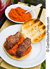Cevapcici with ajvar in the grilled roll - Traditional...