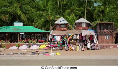 Colourful hats in holiday resort on sandy beach by the sea