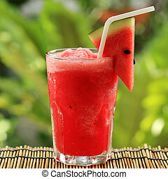 Fresh watermelon smoothie served in the garden