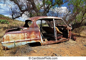 Deserted and Rusted Auto Wreck - Old deserted wreck of a car...