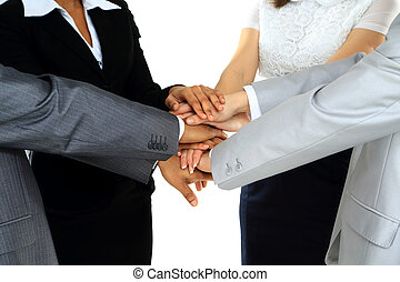 Closeup of business peoples hands making a pile against a...
