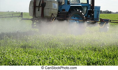 tractor spray herbicide - Tractor spray fertilize field with...