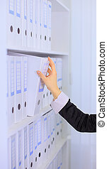 Shelf with folders for documents
