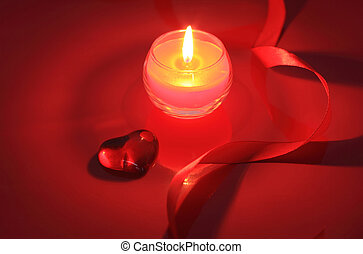 Valentine candle on red background