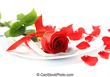 Closeup of red rose on white plate