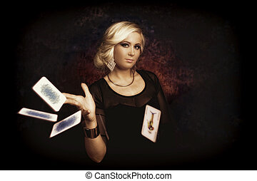 woman with poker cards - Pretty young woman playing with...