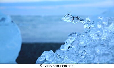 Water drop in blue icebergs and beach - Loopable water...