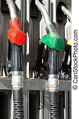 pump nozzles - several gasoline pump nozzles at petrol...