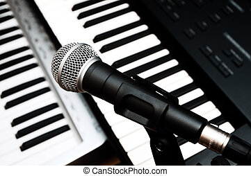 microphone and piano keyboards