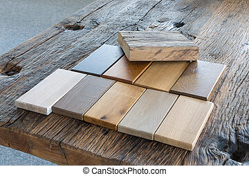 Samples of different kinds of wood in a furniture shop -...