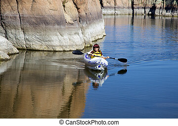 Kayaking on Watson Lake - a woman kayaking on watson lake...