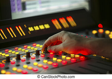 Male hand on control Film Mixing console - Male hand on...