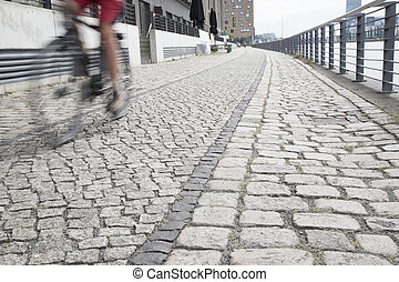 Cyclist on the Embankment of the River Spree, Berlin -...