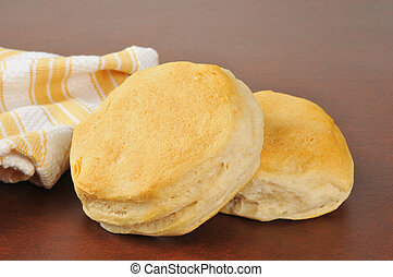 Fresh baked buttermilk biscuits near a kitchen towel