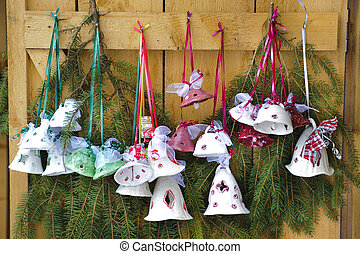 jingle bells as xmas decoration on wooden door