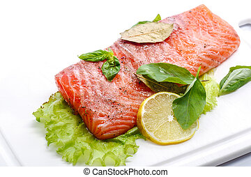 salted salmon fillets - salted red fish with greens on a...