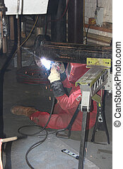 A welder welding a flange