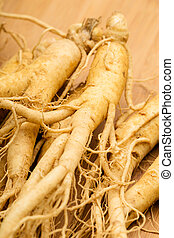 Ginseng with wooden background