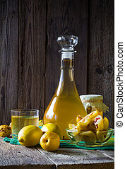 alcohol quince liqueur sliced fruit prepare wooden setting -...