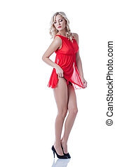 Alluring slim blonde posing in red erotic lingerie, isolated...