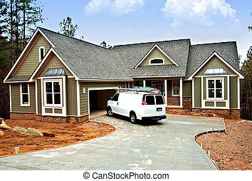 Front Entrance of New Home - A workers van in front of a...
