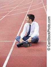 Business competition - A businessman is sitting on the...