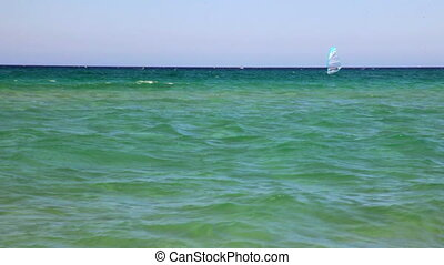 Windsurfing - Windsurfer moving on turquoise water of...